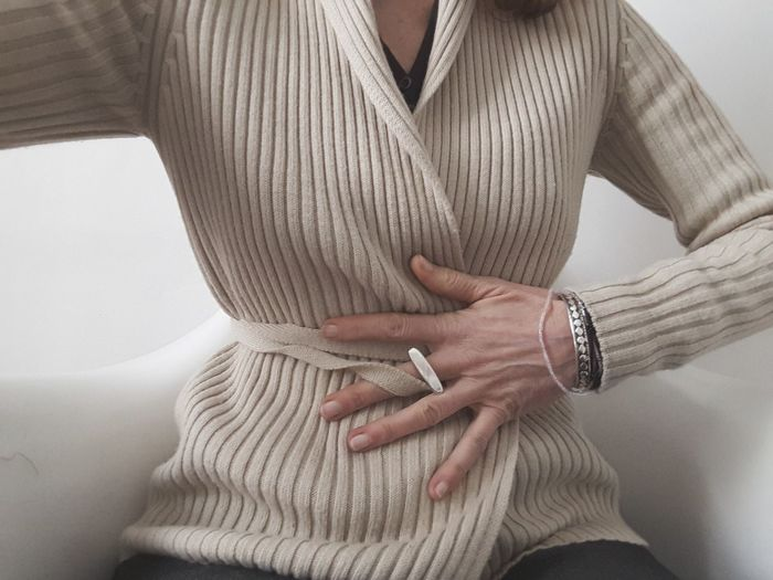 Midsection of woman suffering from stomachache