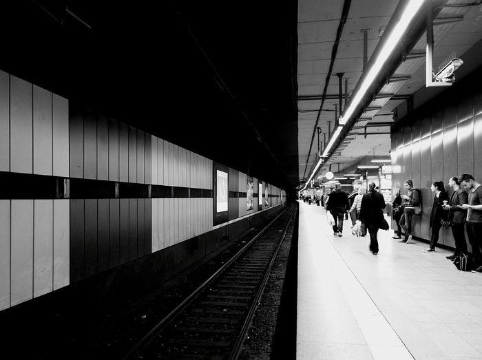 Passengers On Illuminated Railroad Station At Night