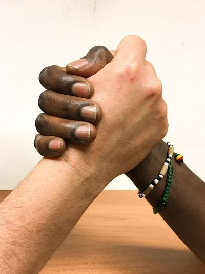 Balance of Opposing Forces 2 Adult Armwrestling Balance Balanceofopposingforces Bracciodiferro Cultures Friendship Human Body Part Human Hand IPhoneography Iphoneonly Mani Men Noracism Only Men Tauziehen Togetherness