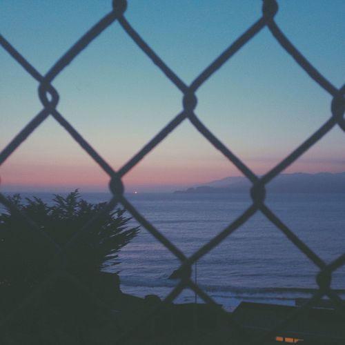 Chainlink fence at sunset