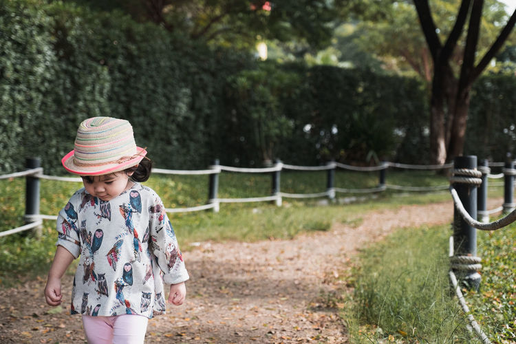 walking forward Walking Tree One Person Outdoors Standing Sun Hat People Grass Childhood Nature Child Smiling Happiness Flower Children Only Fresh On Market 2018