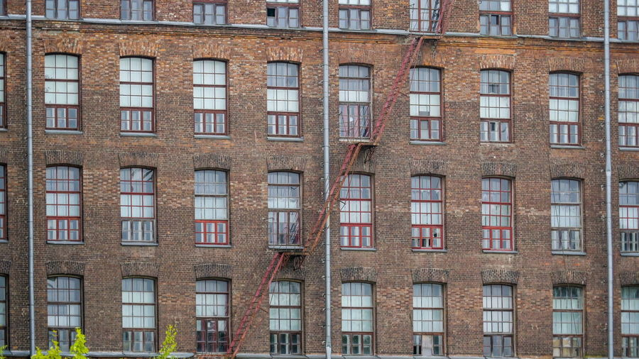 The view from the outside of the Kreenholm building it is an old textile manufacturing factory in Estonia Building Exterior Architecture Window Built Structure Building In A Row Full Frame City No People Low Angle View Brick Day Residential District Repetition Outdoors Side By Side Backgrounds Glass - Material Façade Pattern Apartment Row House Kreenholm Old Textile Factory Narva Exterior Architecture
