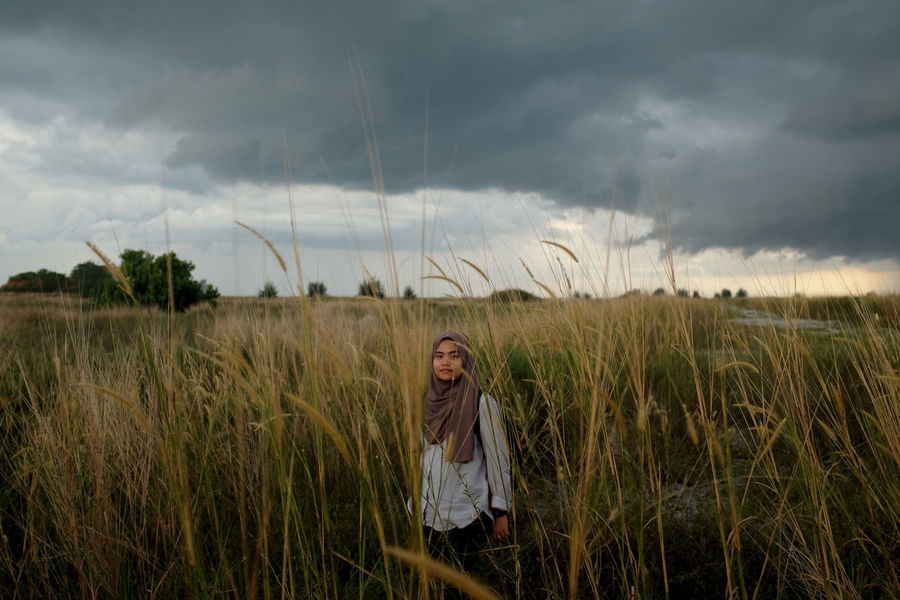 Stand This Is Natural Beauty Malaysia Truly Asia Reclaimed Land Women Sky Melaka Muslim Nature Cloud - Sky Land Plant Field One Person Standing Casual Clothing Landscape Front View Grass Real People Growth Young Adult Leisure Activity Environment Beauty In Nature Outdoors
