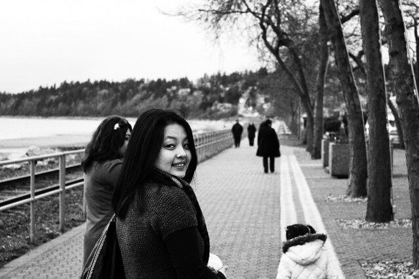 Blackandwhite Black And White Photography Black And White Collection  Black & White Real People Outdoors Leisure Activity Women Young Adult Friendship Only Women Warm Clothing Tree Adult Standing Wireless Technology Simple Moment Love Happiness Place Of Heart The Portraitist - 2017 EyeEm Awards Portrait Photography British Columbia Live For The Story Clear Sky EyeEmNewHere