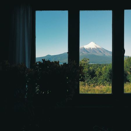 Window Tree Sky Nature No People Business Finance And Industry Mountain Cityscape Cloud - Sky Scenics Indoors  Landscape Day Beauty In Nature Chile Tranquility VolcanOsorno Tourism Vulkan