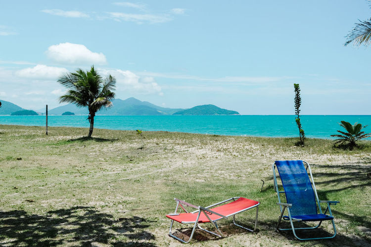 Seascape Sea And Sky Sea Life Seaside Sky Water Land Plant Scenics - Nature Nature Chair Tranquility Beach Beauty In Nature Sea Tree Tranquil Scene Tropical Climate No People Day Mountain Palm Tree Deck Chair Outdoors