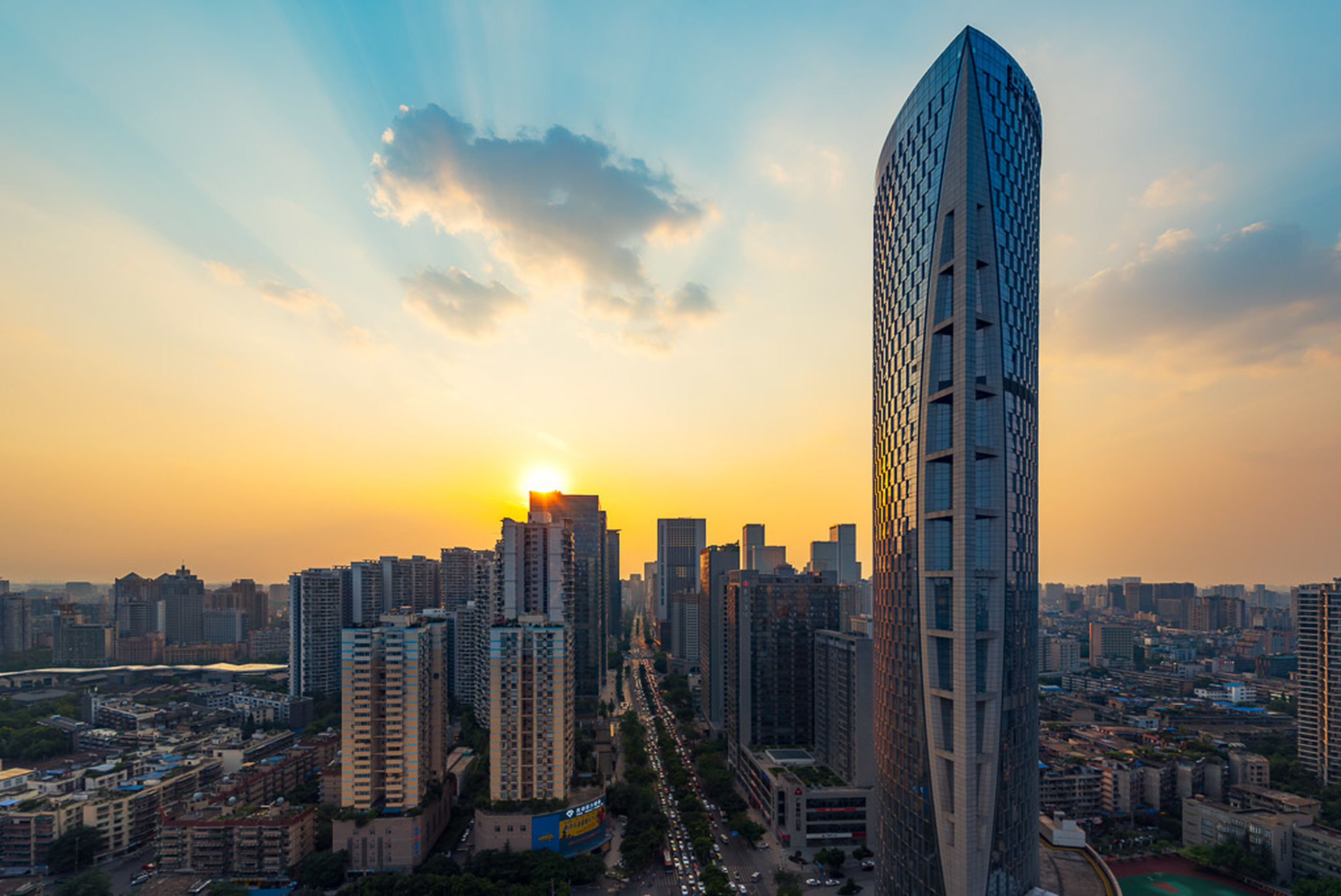 architecture, skyscraper, sunset, building exterior, city, cityscape, built structure, modern, sky, no people, cloud - sky, outdoors, urban skyline, day