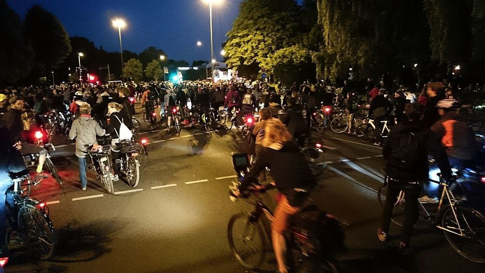 Architecture Bicycle Biker City Crash Helmet Critical Mass Crowd Group Of People Helmet Illuminated Land Vehicle Large Group Of People Lifestyles Mode Of Transportation Motor Vehicle Motorcycle Night Outdoors Real People Ride Riding Road Street Transportation