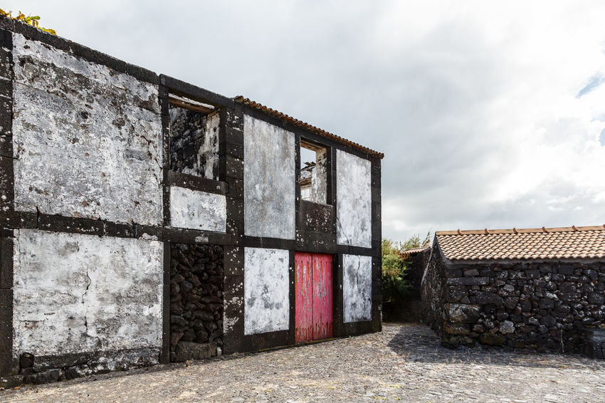 Azores Pico Island Traditional House Abandoned Architecture Basaltic Rock Building Building Exterior Built Structure Cloud - Sky Day House Land Low Angle View Nature No People Old Outdoors Sky Solid Sunlight Wall Wall - Building Feature Weathered