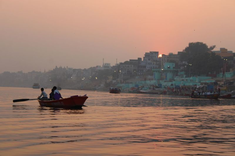 Sunset on the River Ganges Varanasi, India Ganges, Indian Lifestyle And Culture, Bathing In The Ganges, Nautical Vessel Water Transportation Mode Of Transportation Sky Building Exterior Real People