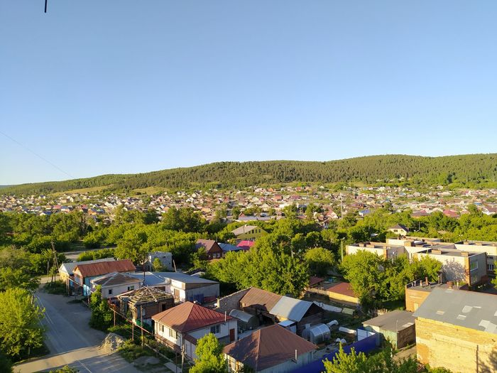 High angle view of townscape against clear blue sky
