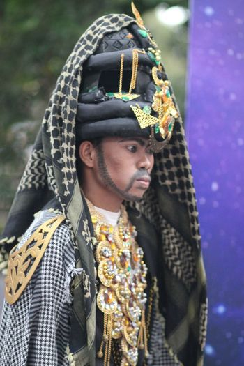 Man In Traditional Clothing Looking Away Outdoors