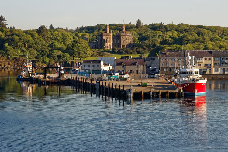 Stornoway Harbour, Isle of Lewis, Outer Hebrides,Scotland. Harbour Lighthouse Outer Hebrides Tranquility Cruise Fishing Industry Jetty Sailboat Seawall Supply Vessel Town Hall Travel Destinations Trawler Western Isles Health Board Wharf