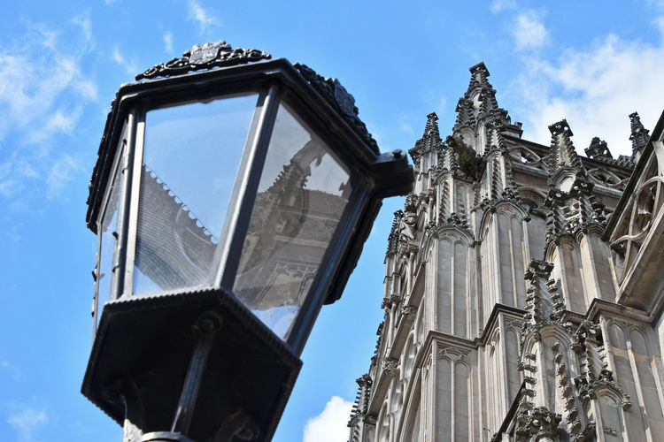Low Angle View Of Church And Street Light Against Sky