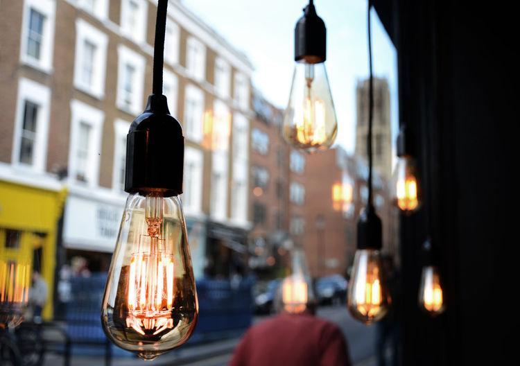 Close-Up Of Illuminated Light Bulbs Hanging Indoors