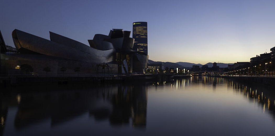 Sunset at the the Guggenheim Museum in Bilbao, Spain. Architecture Built Structure Building Exterior Travel Destinations Basque Country Bilbao Bilbaoarchitecture Reflection Long Exposure Lights Guggenheim Bilbao Guggenheim Museum Titanium Illuminated Water Sky Outdoors Building River Canonphotography Cityscape Urban Landscape Urbanphotography City Clear Sky Blue Hour Cityscape Blue Hour
