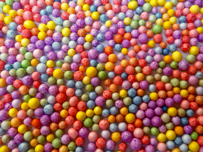 Directly above colorful polystyrene balls on table