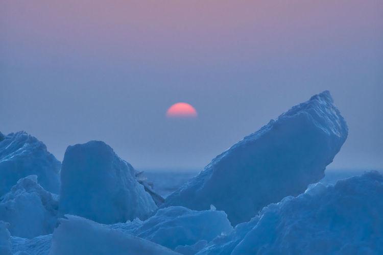 View of iceberg against sky