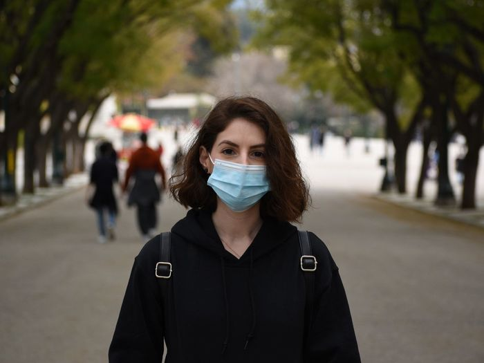 Portrait of a beautiful young woman wearing a mask during the quarantine in athens, greece