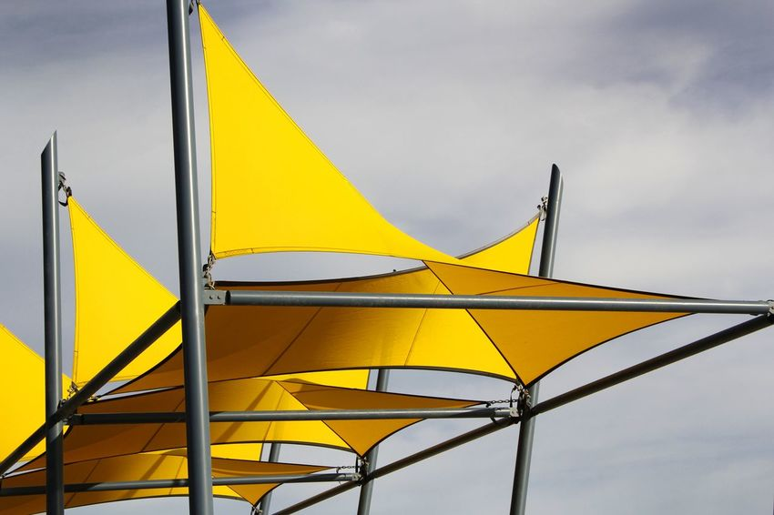 Shade Sails spread to provide protective sun cover Abstract Abstract Photography Arcitecture Close-up Cove Cover Protectio Day Decoration Decorative Design Designing Low Angle View No People Outdoors Pattern Prevent Shadeclo Shadecloth Shadow Style Sun Sunblock Sunset Sunshade Yellow