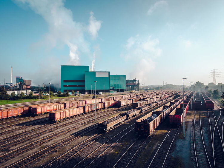 Day view of steel mill Chimney Exterior Industrial Industry Plant Rails Building Exterior Cloud - Sky Day Environment Factory Factory Building Industry Manufacture No People Outdoors Rail Transportation Railcar Railroad Track Railway Sky Smokestack Steel Mill Steelworks Transportation