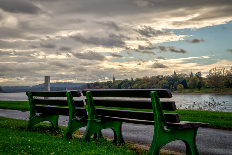 Park bench Rhine Rhine River, Germany Sunlight Beauty In Nature Cloud - Sky Day Grass Green Color Nature No People Outdoors Scenics Sky Sunset Tranquility Tree Water