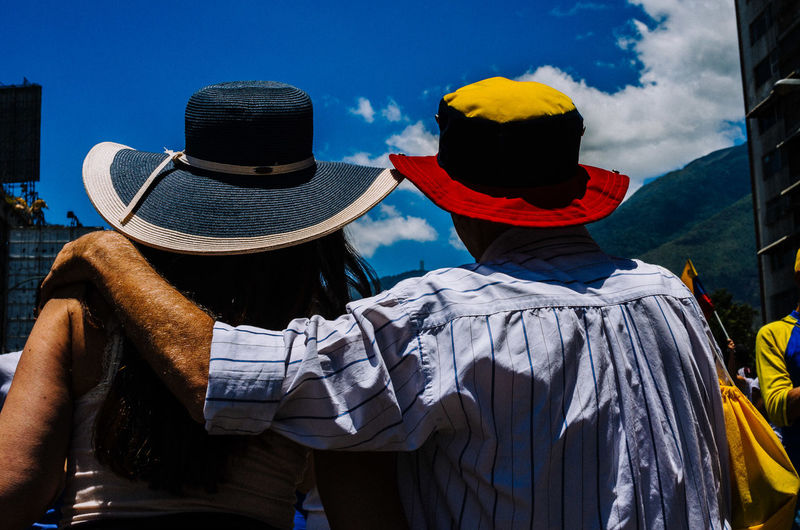 Human condition The Art Of Street Photography Hat Rear View Real People Clothing Sky Day Men Nature Cloud - Sky Waist Up Lifestyles Standing Sunlight People Togetherness Outdoors Leisure Activity Looking At View Streetphotography Street Photography EyeEm Best Shots EyeEm Selects