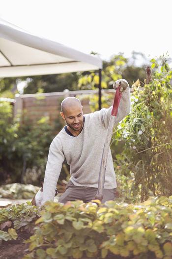 Full length of man standing against plants