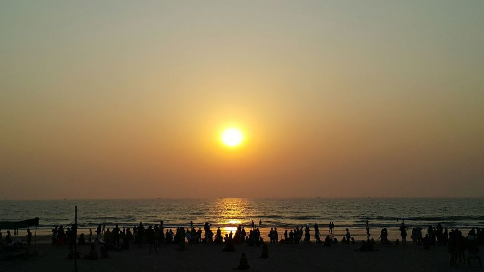 Sea Sunset Beach Horizon Over Water Sun Sand Scenics Outdoors Tranquility Idyllic Beauty In Nature Large Group Of People Nature Water Tranquil Scene Sky Travel Destinations Silhouette Vacations People Romantic Sky Togetherness Goa India Arambol Beach