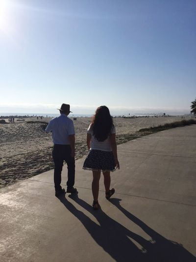 Miles Away Two People Rear View Sea Beach Real People Full Length Leisure Activity Lifestyles Togetherness Clear Sky Horizon Over Water Sand Walking Bonding Son Vacations Family Sunlight Outdoors Water Uniqueness San Diego Quiet Places Breathing Space
