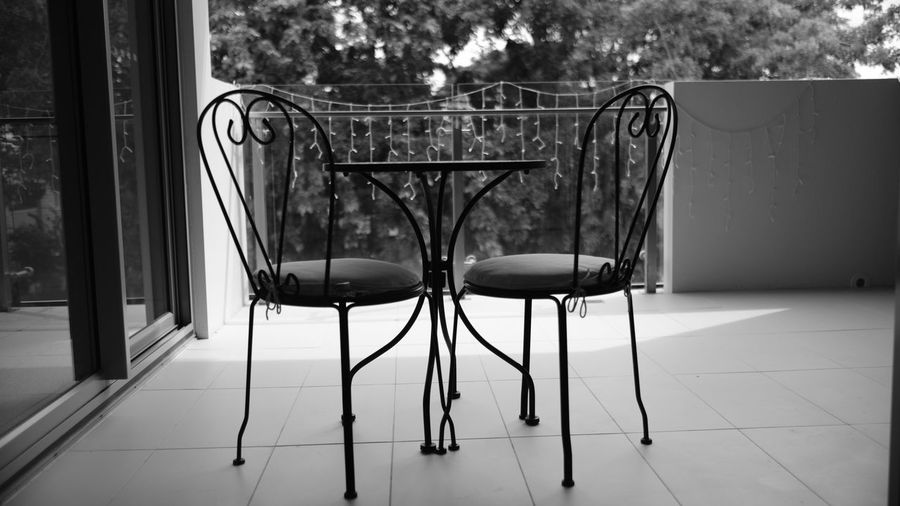 Balcony Balcony View Black & White Black And White Blackandwhite Chair Day Fujifilm Metal Monochrome No People Outdoor Furniture Outdoor Play Equipment Outdoors Seat Tree