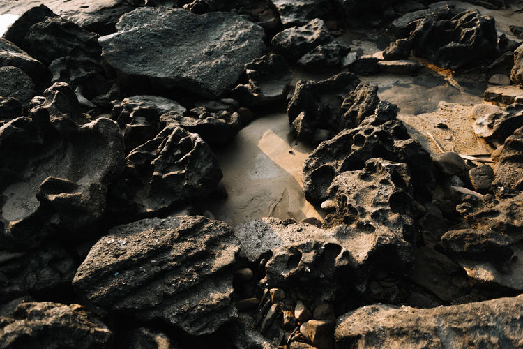 rock stone Dark Backgrounds Beauty In Nature Close-up Day Eroded Full Frame Geology High Angle View Land Nature No People Outdoors Pattern Rock Rock - Object Rock Formation Skin Solid Stone Stone - Object Sunlight Texture Tranquility
