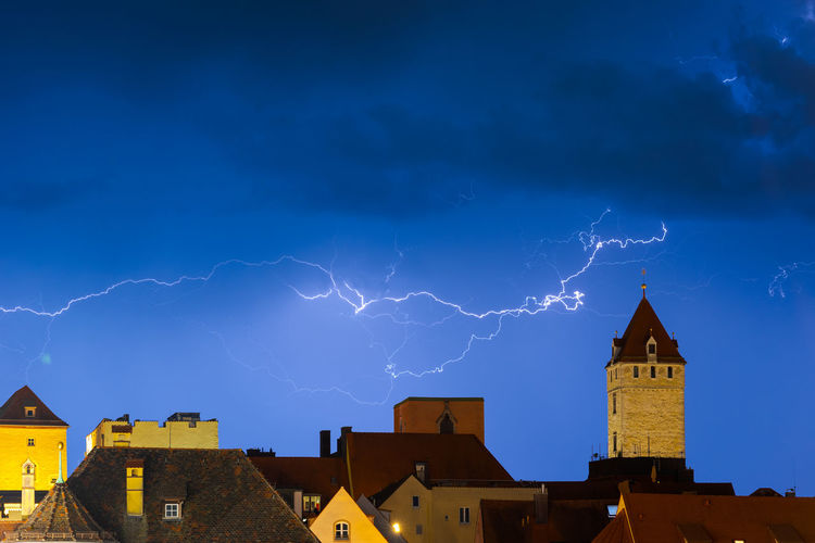 Lightning over buildings in city at night