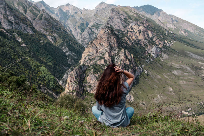 Rear view of young woman looking at mountain