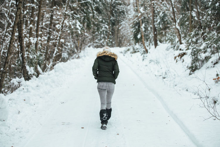 Nature Winter Beauty In Nature Cold Temperature Day Forest Full Length Leisure Activity Lifestyles Nature One Person Outdoors People Real People Rear View Road Snow The Way Forward Tree Walking Warm Clothes Warm Clothing Weather Winter Young Adult
