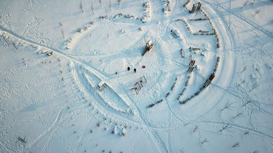 High angle view of tire tracks in snow