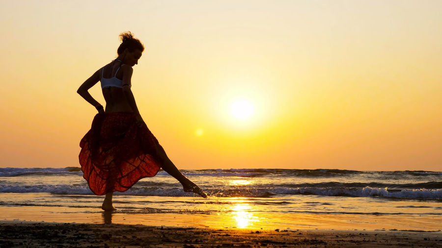 Woman on beach during sunset