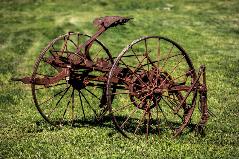 Abandoned Damaged Day Deterioration Field Grass Green Color Land Nature No People Obsolete Old Outdoors Plant Run-down Rusty Transportation Wagon Wheel Wheel