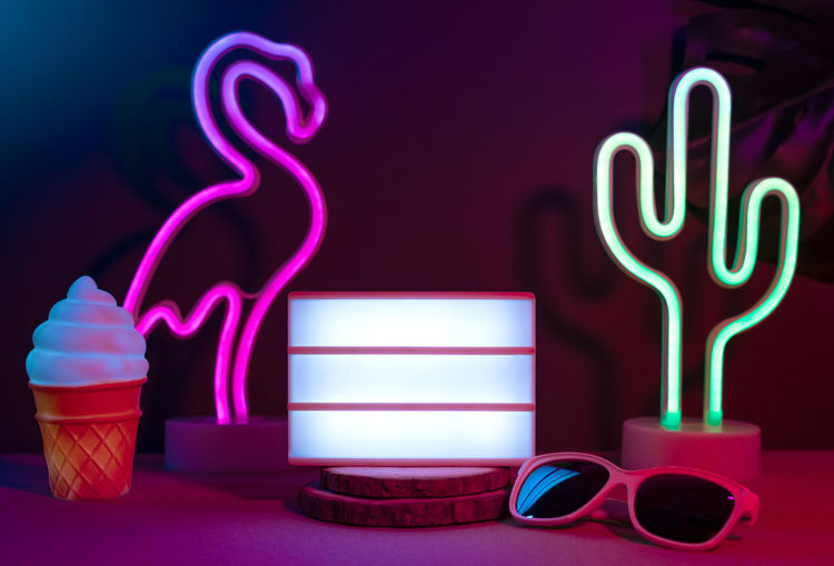 Close-up of illuminated light painting on table