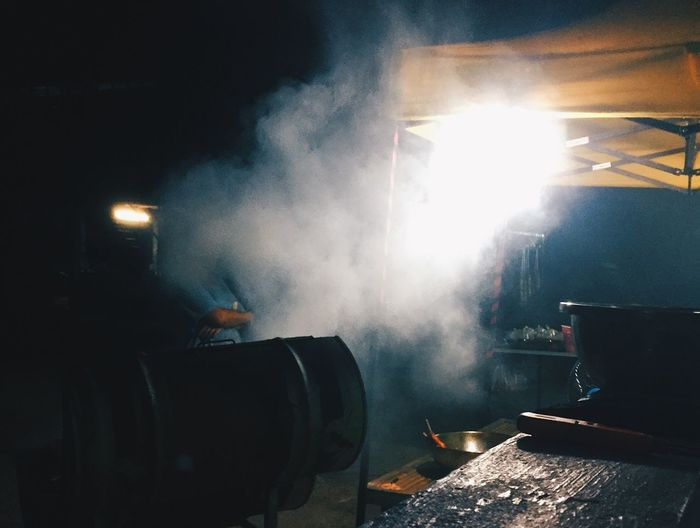 Smoke - Physical Structure Illuminated Night Indoors  Real People Heat - Temperature Nature Lens Flare Lighting Equipment Steam One Person Occupation Factory Stage Event Glowing Burning Festival Fire