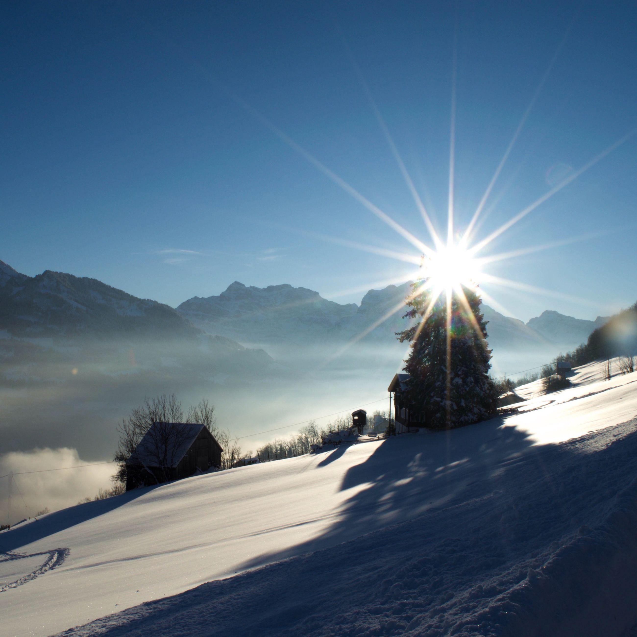 snow, sun, winter, cold temperature, sunbeam, sunlight, mountain, landscape, lens flare, tranquil scene, tranquility, sky, scenics, nature, beauty in nature, mountain range, season, sunny, snowcapped mountain, blue