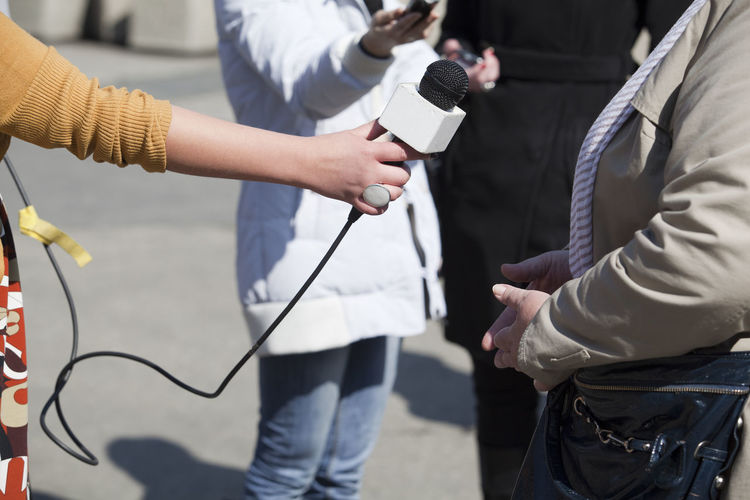 Journalist at work. Media interview. Journalist Answering Questions Asking Questions Broadcasting Journalism Communication Holding Human Hand Information Journalism Media Event Media Interview Microphone Report Reporter