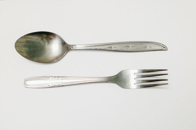Metal Studio Shot Silver Colored Kitchen Utensil Eating Utensil Steel White Background Indoors  Fork Spoon Household Equipment Close-up Silver - Metal Still Life Alloy Cut Out No People Stainless Steel  Shiny High Angle View Table Knife Crockery