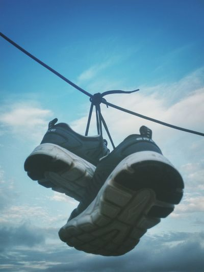 My Sneaker Drying up in the Open Sky. Shoes Sneaker Sportshoes Sportswear Vintage Bestshoes Mobography Smartphonephotography Mobilephotography Hanging Hangingshoes Wires Drying Off No People Day Out Of The Box EyeEmNewHere Place Of Heart Clouds And Sky Cloud Opensky Cloudy Be. Ready.