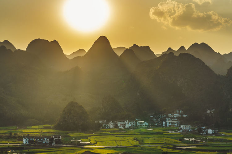 Sunset with Evening light and Sky at Wanfenglin Viewpoint, Forest of Ten Thousands Peaks in Guizhou Province, China. Beautiful Farm Field Guizhou Nature Relaxing Travel Trees View Beauty In Nature China Colorful Forest Gold Colored Golden Hour Heritage Landscape Mountain Sky Valley Viewpoint WanFengLin