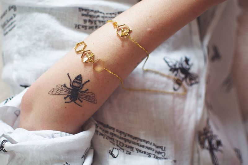Bee line. Body Arts Insect Bee Tattoo One Person Human Body Part Hand Human Hand Tattoo Close-up Text Jewelry Body Part Creativity Representation Women Lifestyles Human Limb The Still Life Photographer - 2018 EyeEm Awards 50 Ways Of Seeing: Gratitude