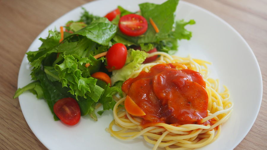 Spaghetti with tomato sauce and green salads on a white plate Cuisine Culinary Dinner Ingredients Lunch Cherry Tomato Close-up Food Freshness Fruit Garnish Healthy Eating Herb Indoors  Italian Food Pasta Plate Ready-to-eat Serving Size Spaghetti Still Life Table Temptation Tomato Vegetable The Still Life Photographer - 2018 EyeEm Awards A New Beginning