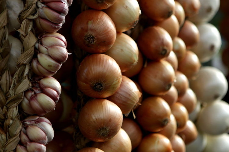 Full frame shot of onion and garlic for sale