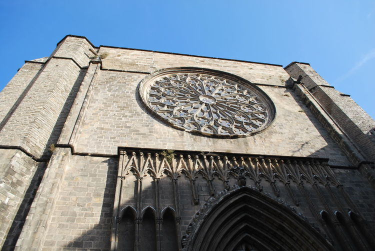 Architecture Astronomical Clock Astronomy Barcelona Barcelona, Spain Building Building Exterior Built Structure Catalonia Catalunya Church Clock Clock Face Clock Tower Day Low Angle View Minute Hand No People Outdoors Rose Window Sky SPAIN Time Tower Travel Destinations