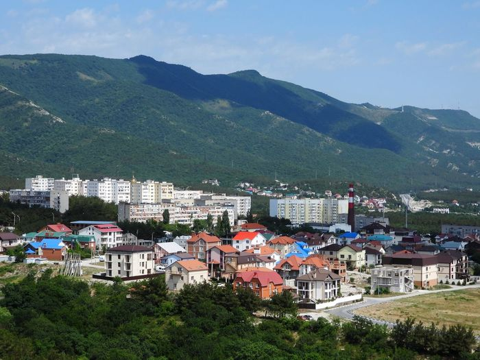 High angle view of townscape and mountains against sky